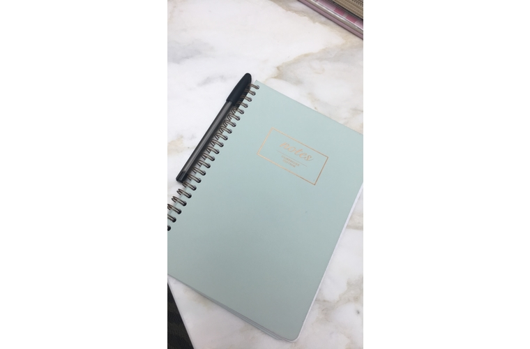BRCA notebook on a marble table