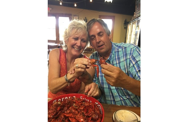 Dad and Val holding crawfish