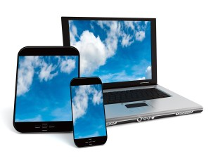 A tablet, a mobile phone and a laptop with a sky with clouds on
