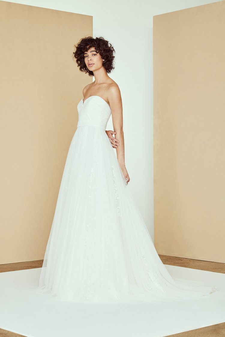 Black model in Amsale wedding dress