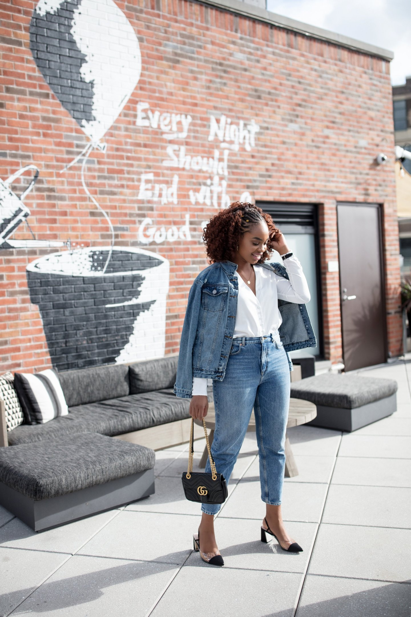 Lifestyle blogger Ijeoma Kola wears denim on denim outfit with and other stories mom jeans, zara acrylic slingbacks, and gucci marmont bag
