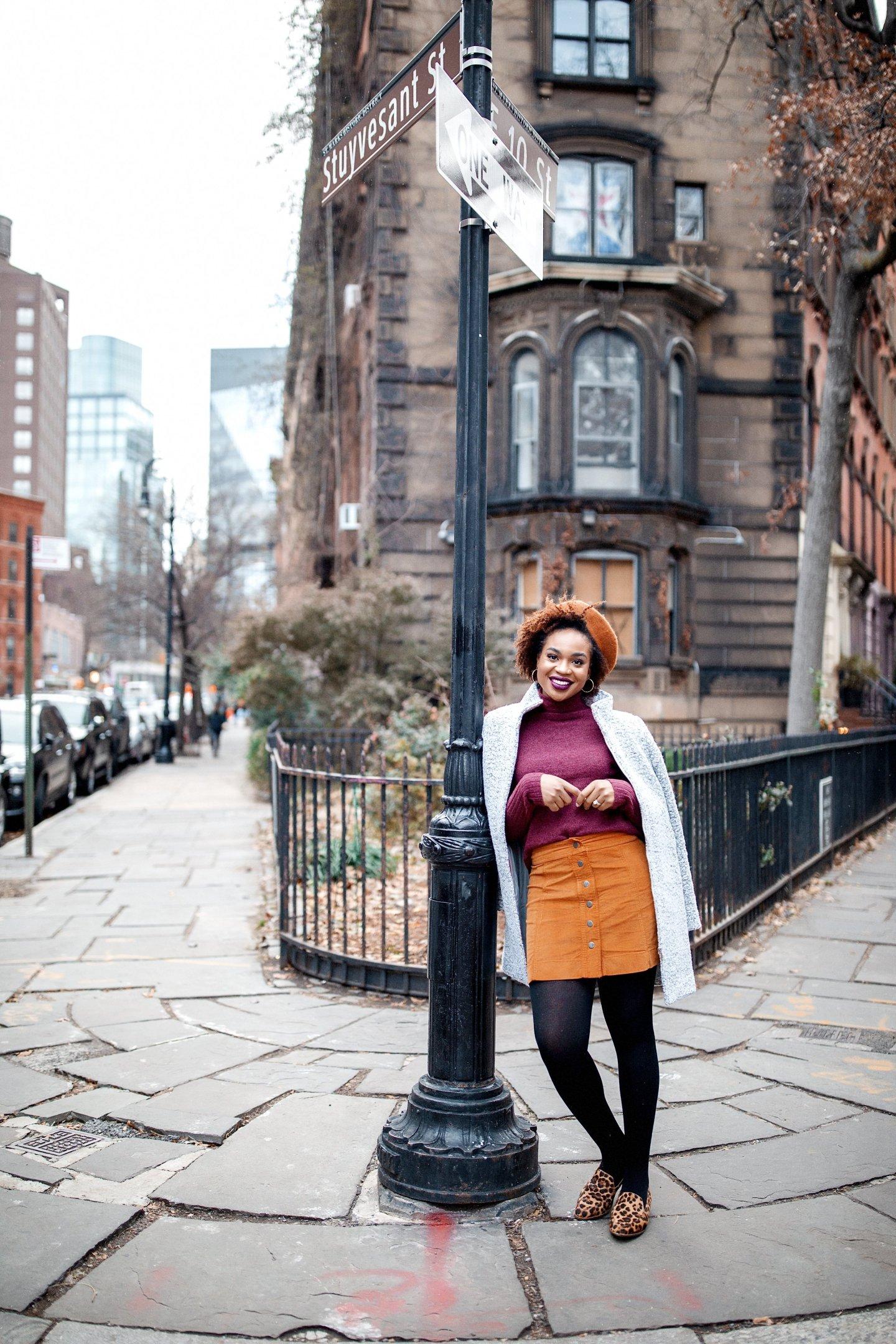 NYC Fashion Blogger Ijeoma Kola wearing Fall Outfit Madewell Burgundy Turtleneck Mustard Skirt Leopard Loafers Beret and LOFT Grey Coat