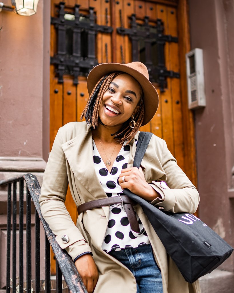 Fashion blogger Ijeoma Kola wears C/meo collective polka dot blouse and belted trench coat