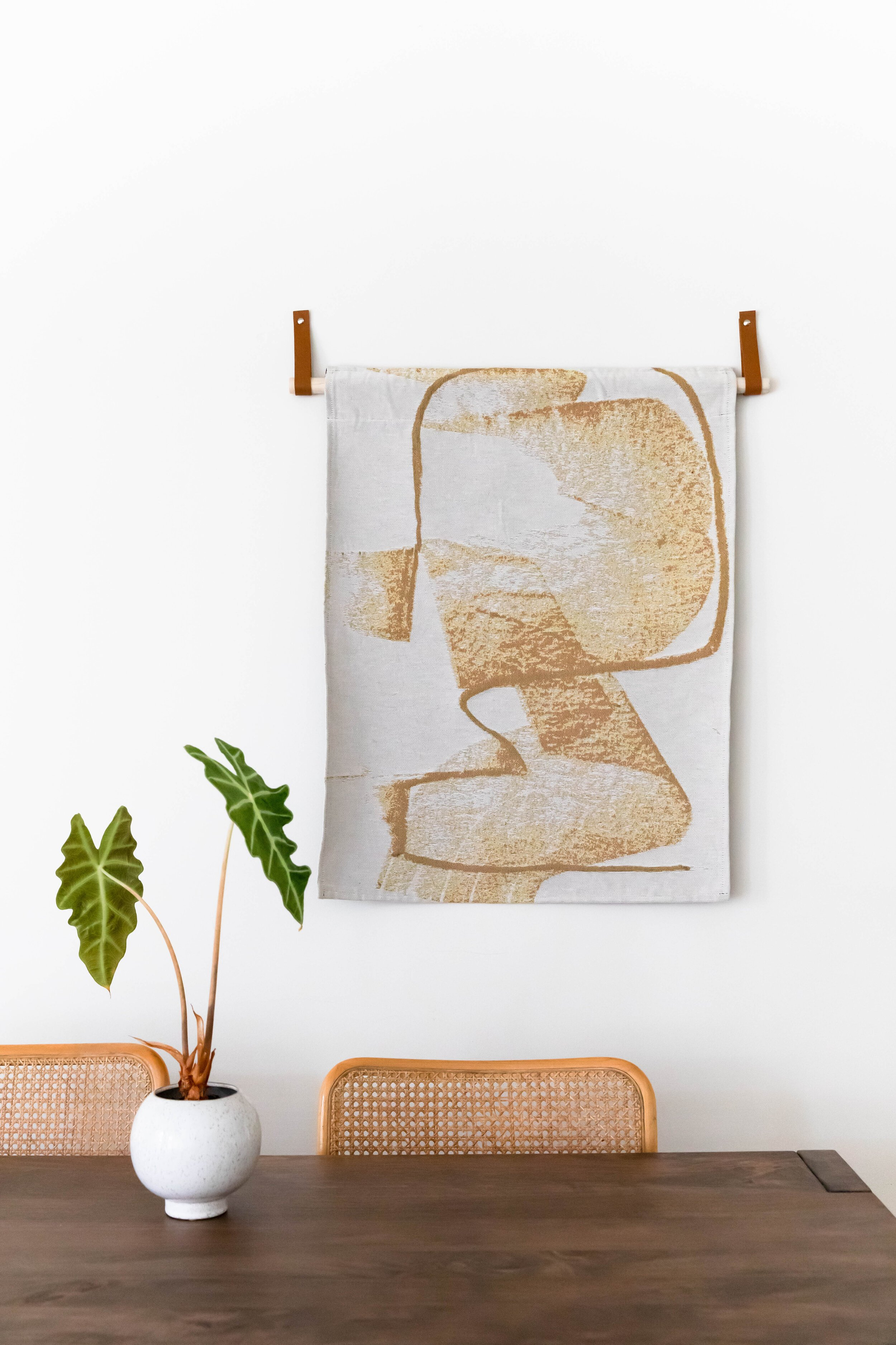 Pot plant on wooden table and wall art