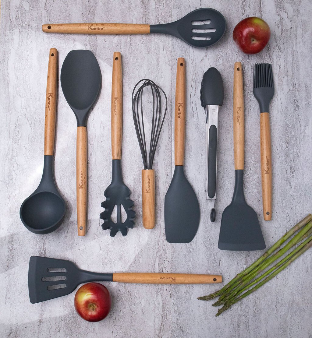 Wood and silicone kitchen utensils with apples and asparagus