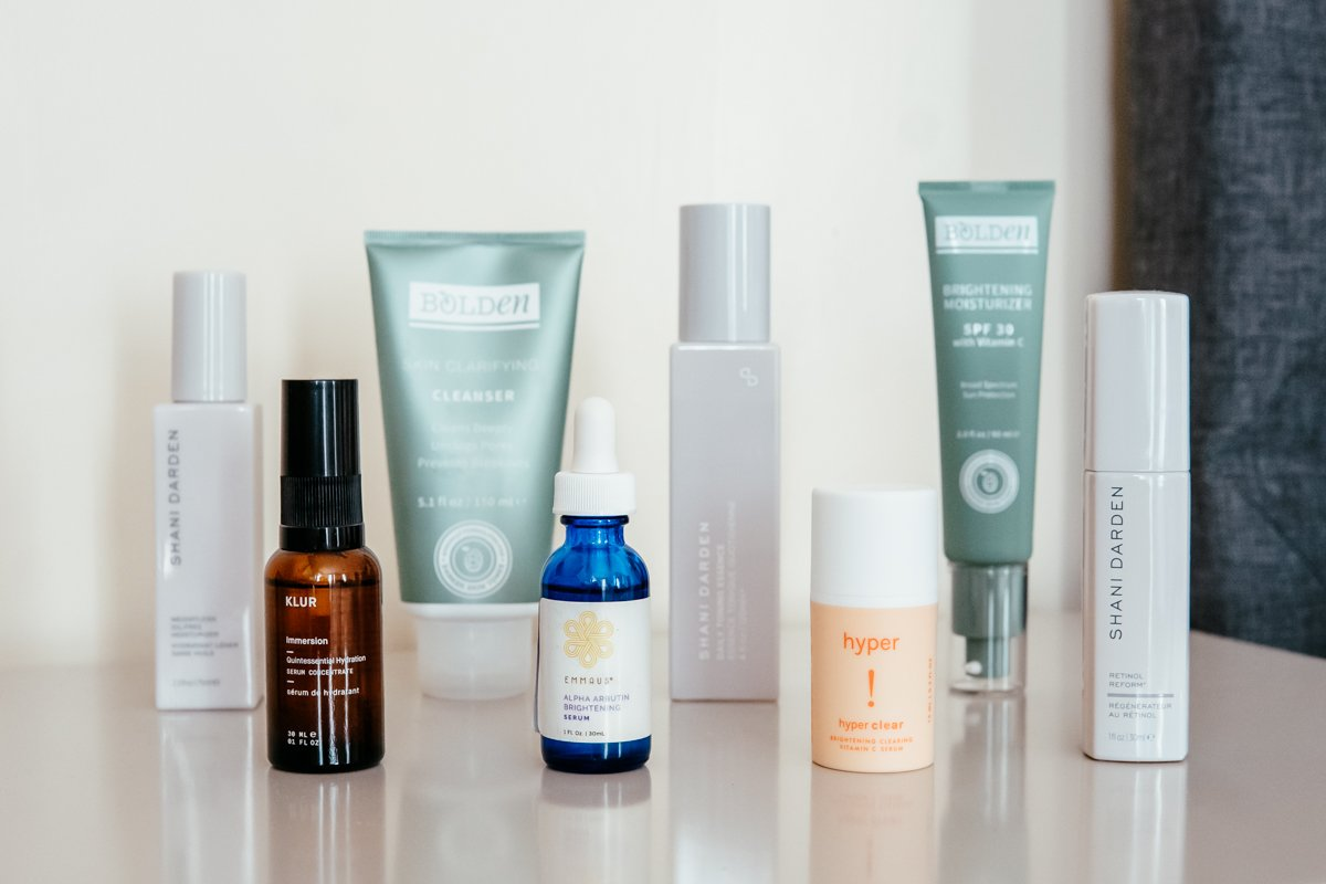 8 skincare products on table from Black owned brand