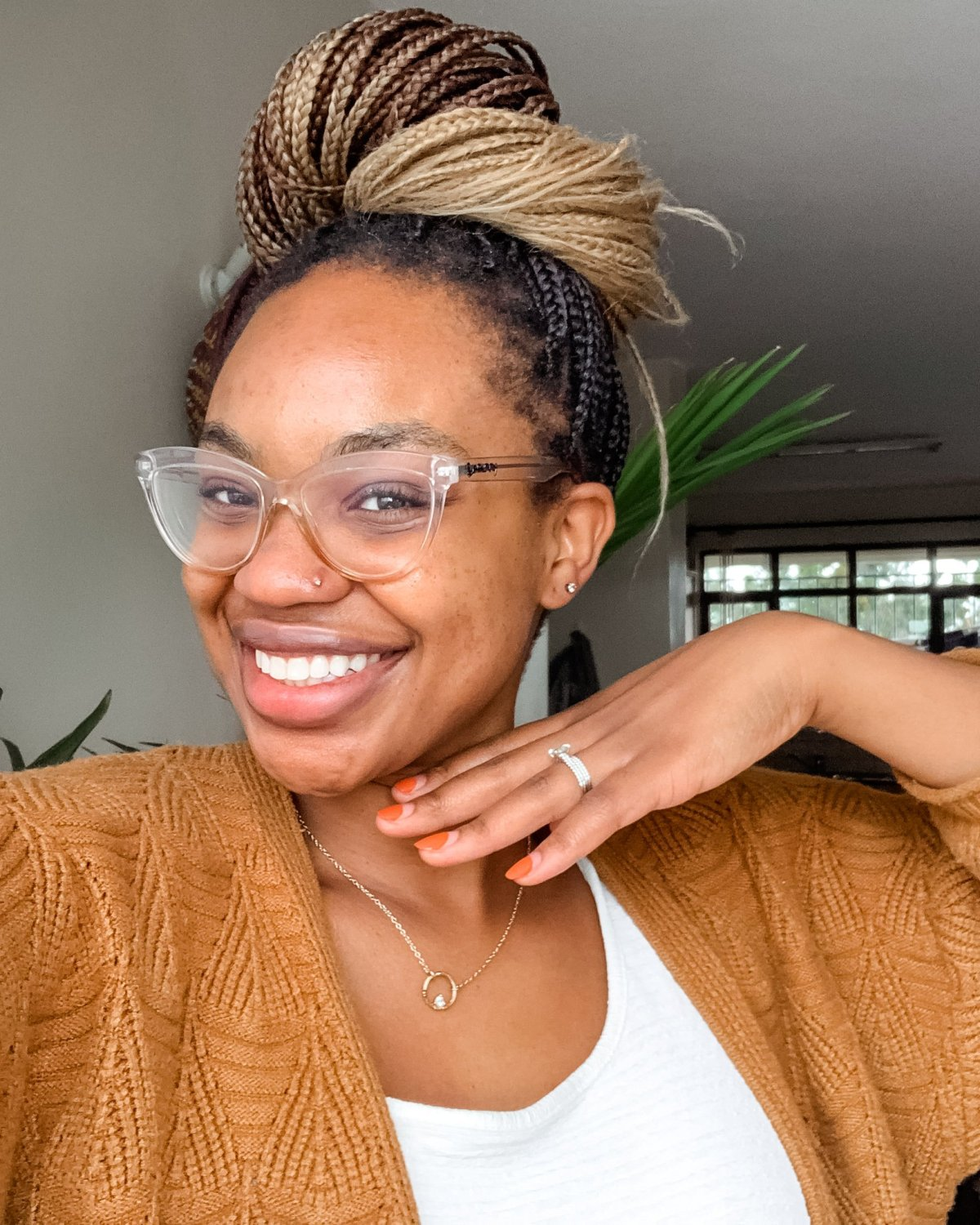 Ijeoma Kola Smiling with Glasses and High Braids Bun