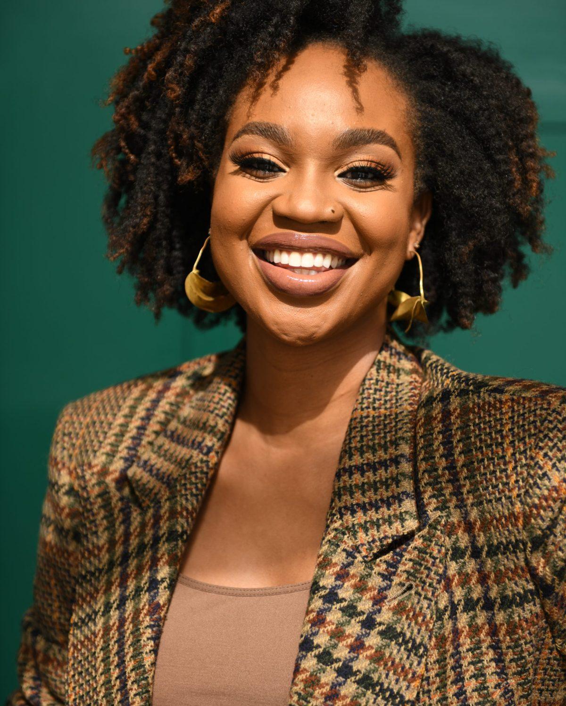 Ijeoma Kola headshot on green background - hairstyles for black women