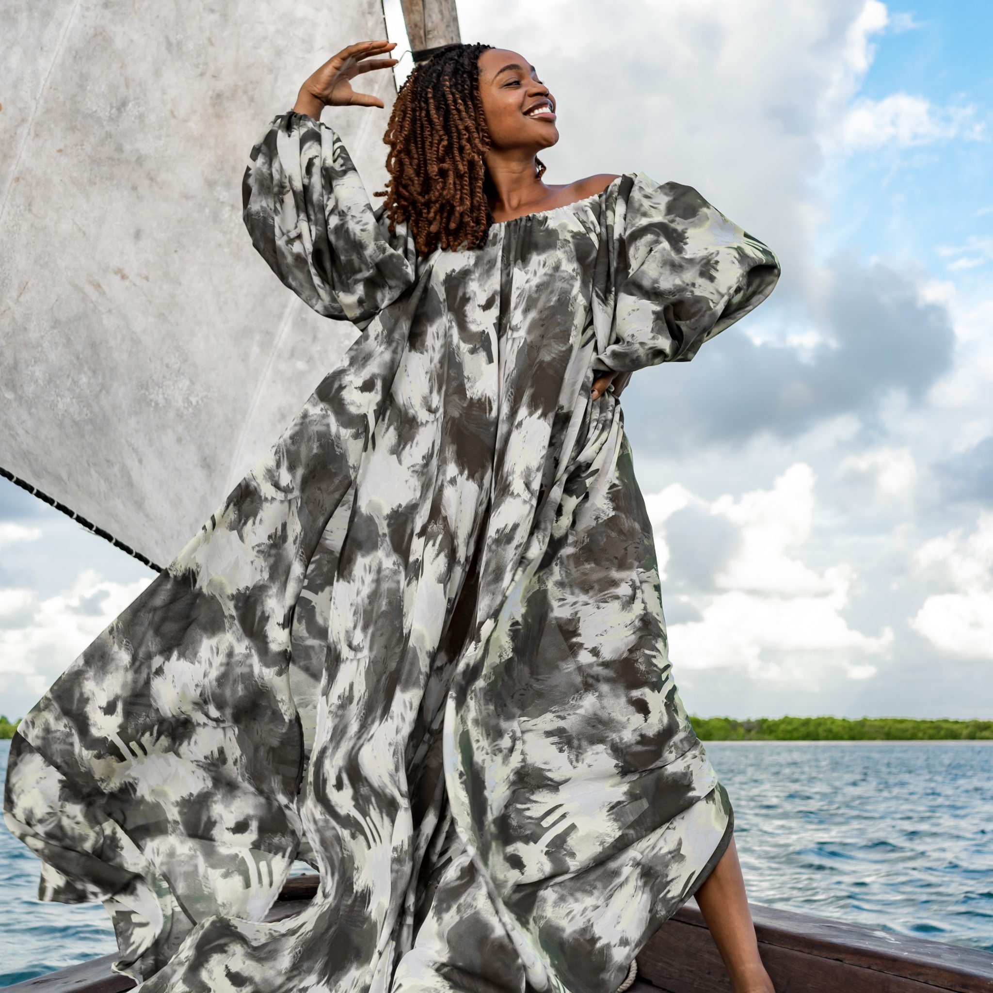 Ijeoma Kola in print dress on boat - Featured Image for October Q&A on Mom Guilt, Baby Weaning, US Elections and More!