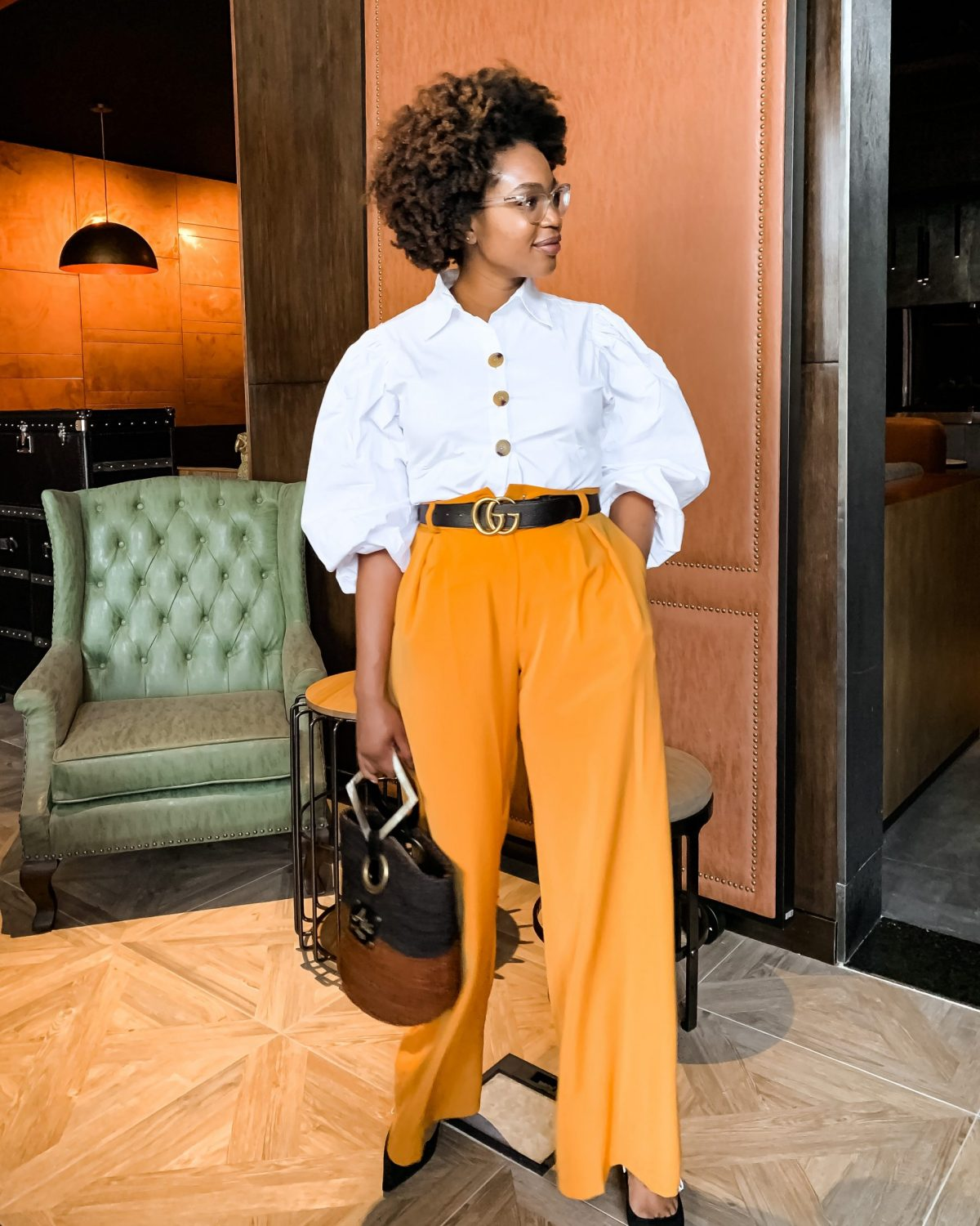 Ijeoma Kola in white top and orange pants
