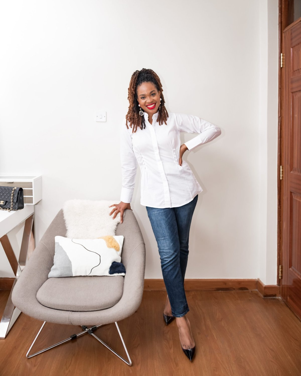 Ijeoma Kola in white top from Black owned fashion brands and jeans