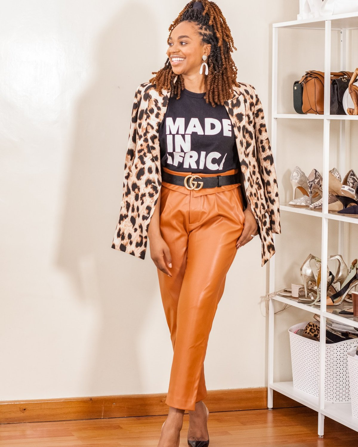 Ijeoma Kola in leopard print blazer, orange leather pants and black tee