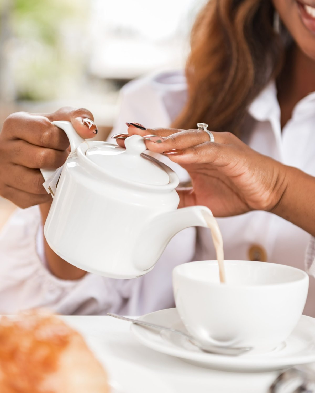 Close up of Ijeoma Kola's hands pouring tea into tea cup - Blog on social media and mental health