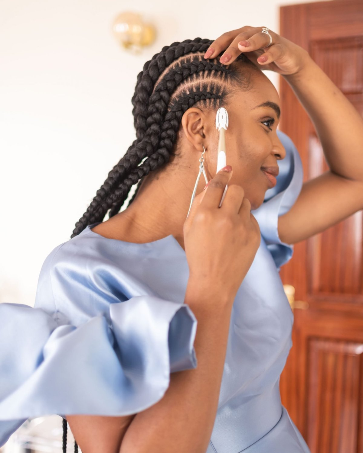 Ijeoma Kola laying edges with toothbrush - how to recycle