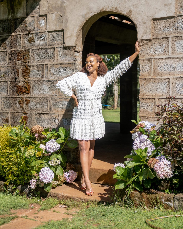 Ijeoma Kola in white summer dress posing outdoors