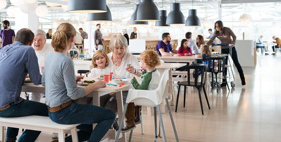Families and friends eating and socilaizing at an IKEA Restaurant.