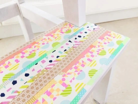 Apply washi tape onto the top and bottom step of the IKEA BEKVAM