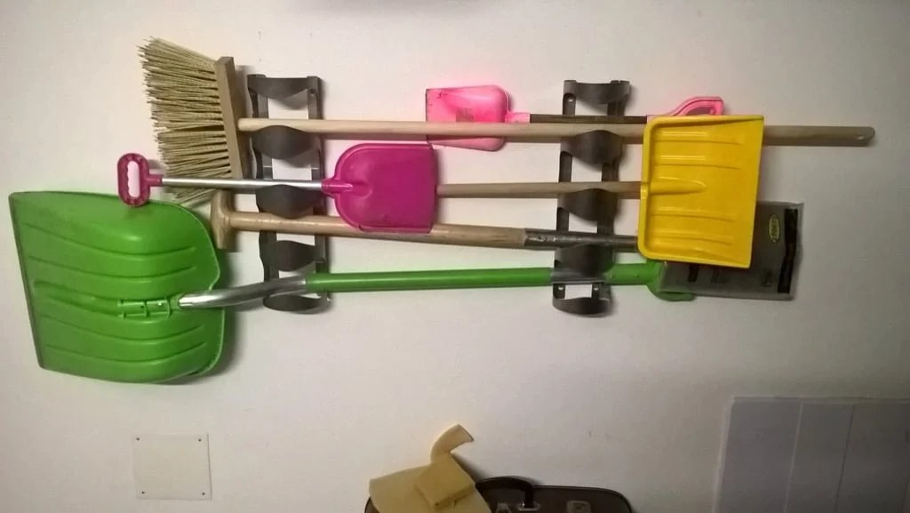 IKEA VURM wine bottle rack as shovel holder