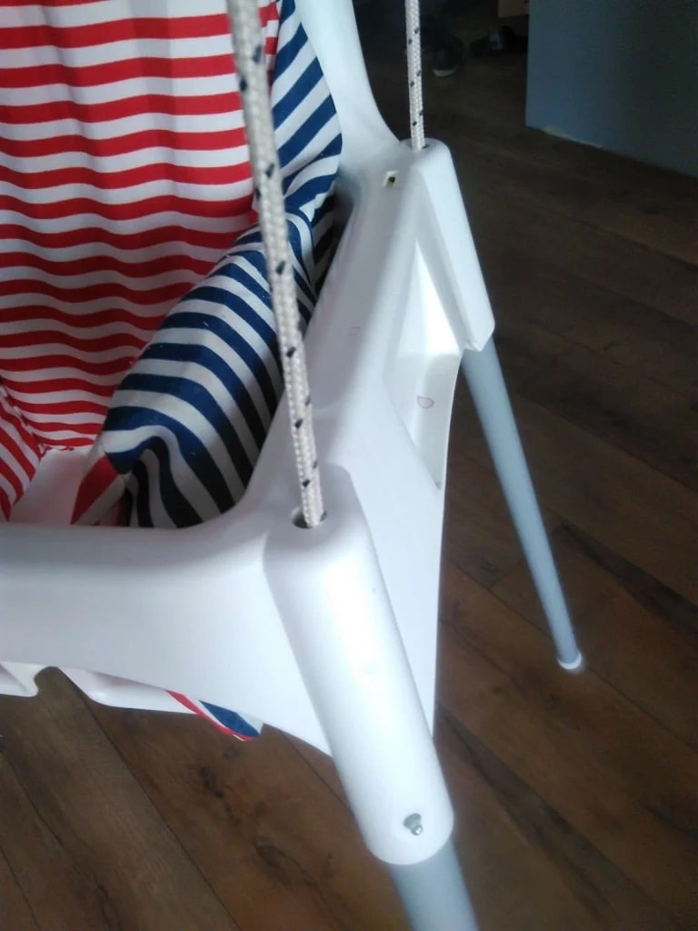 Make a toddler swing from a high chair. A reversible hack.