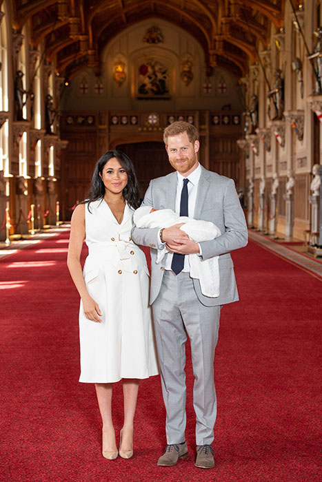 Meghan and Harry posing with newborn Archie