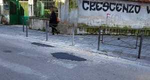 asfalto sulle buche