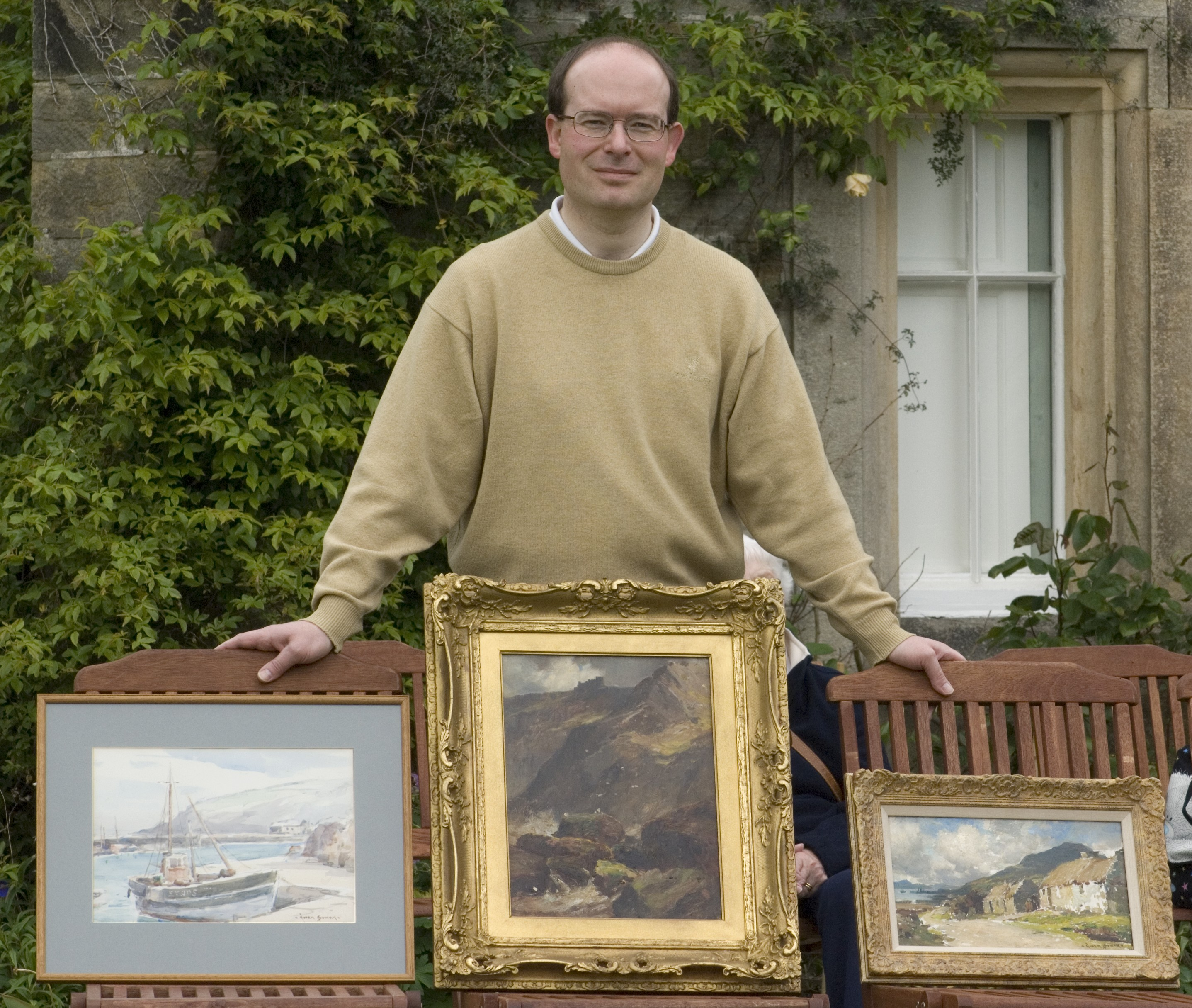 Coun Heathcliffe Bowen with his paintings. Picture by Ivor Hughes