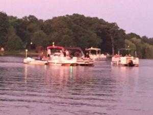 Some of the pontoon boats anchored in Candlewick Lake waiting for the sun to set and the 4th of July fireworks to begin