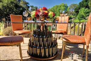 """Wine Bottle Tables 60"""" Glass Tops x 30""""h"""
