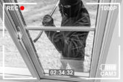 Cctv,View,Of,Burglar,Breaking,In,To,Home,Through,Window