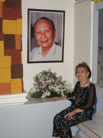 """In this 2011 file photo, Mrs. Porfiria """"Porfing"""" Raval, widow of the late Atty. Castor Raval Sr., is shown seated in front of her husband's giant portrait during a visit at his mausoleum. Sir Castoring's 4th death anniversary is observed this September 13, 2013.(Photo courtesy of Dondi Raval's Facebook/Text by Sentinel)"""