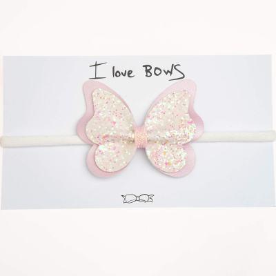 Κορδέλα, πεταλούδα, γκλίτερ άσπρο-ροζ, δερματίνη ροζ