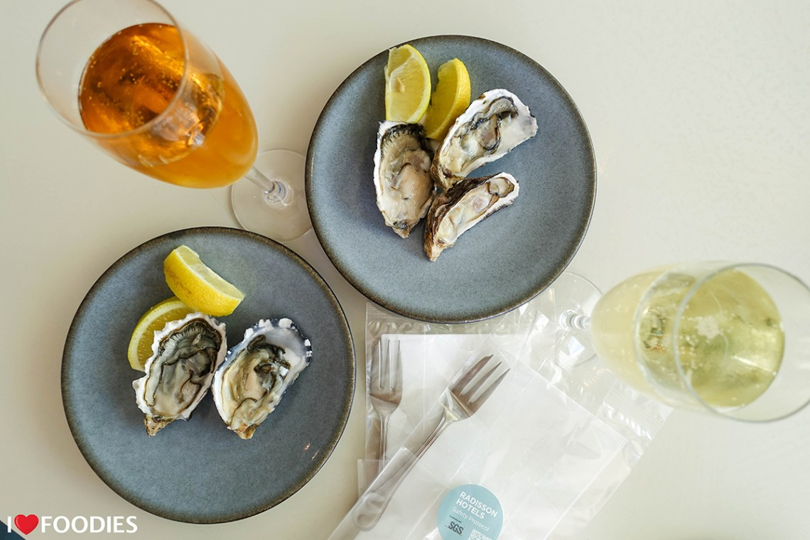 Oysters and prosecco with Covid-safe cutlery