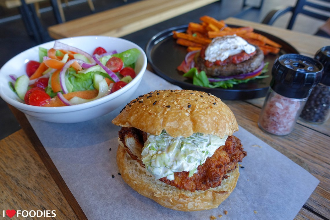 A selection of burgers at the Bootlegger Coffee Company - their Kentucky-Style Chicken Burger with a side salad & the No-Bun Beef Burger with sweet potato fries