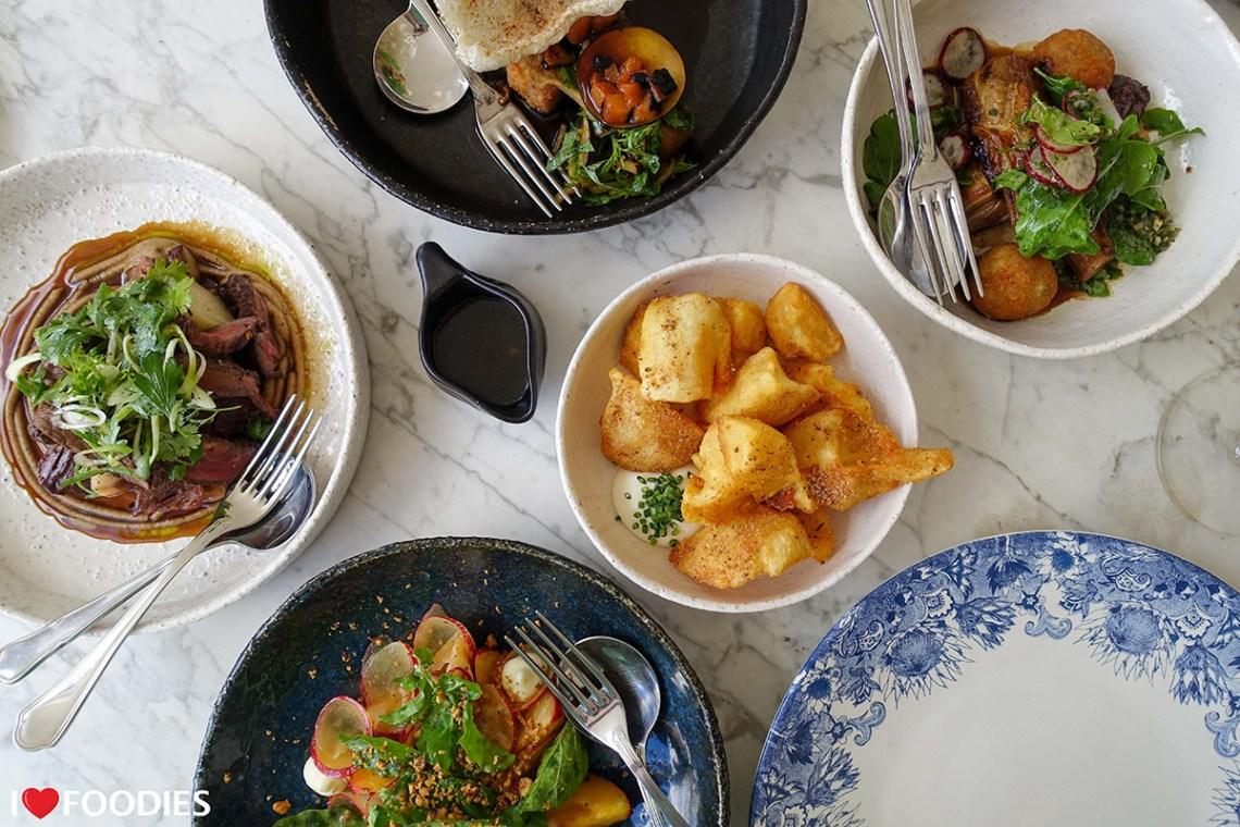Werf restaurant tapas dishes - seared Angus beef fillet, plum salad, crispy potato, lamb ribs, pork belly