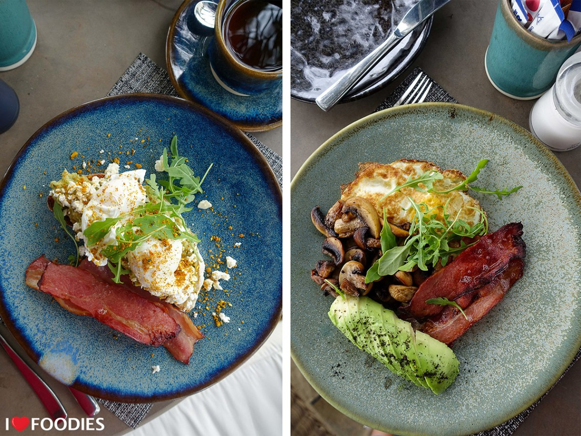 Smashed avocado toast with bacon and scrambled eggs with grilled mushrooms, bacon, and avocado