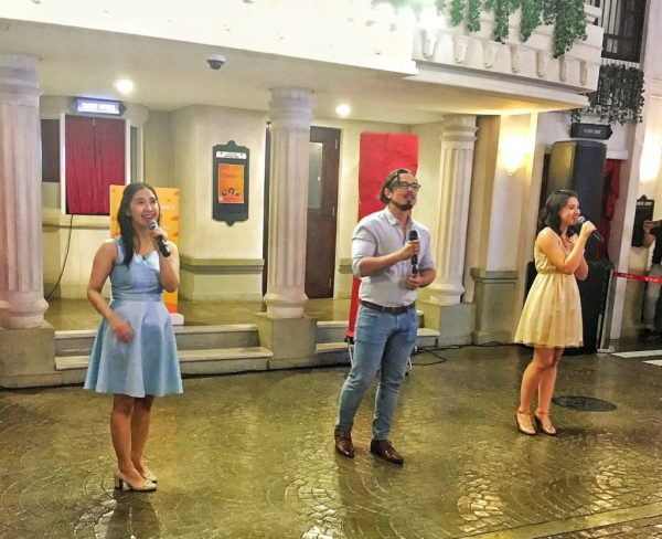 Mitzie Lao, George Schulze, and Becca Coates of 9 Works Theatrical showcase their singing prowess at the play city.