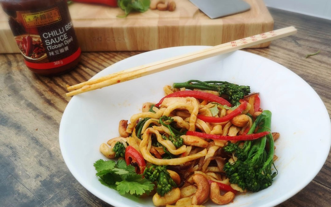 Chicken and stem broccoli stir-fry with egg noodles and Chilli bean sauce