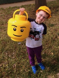 A Lego storage head for $8. A construction helmet for .50c . (They made me take the kid with me)