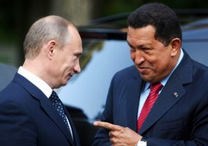 Russia's Prime Minister Vladimir Putin (L) and Venezuela's President Hugo Chavez meet at Novo Ogaryovo residence outside Moscow July 22, 2008. Chavez, a fire-brand Socialist, will sign arms and energy deals during a visit to Moscow which started on Tuesday, moves likely to further strain ties between Russia and the United States. REUTERS/Miraflores Palace/Handout (RUSSIA)