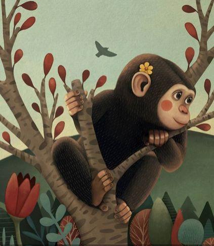 mono colgado de un arbol