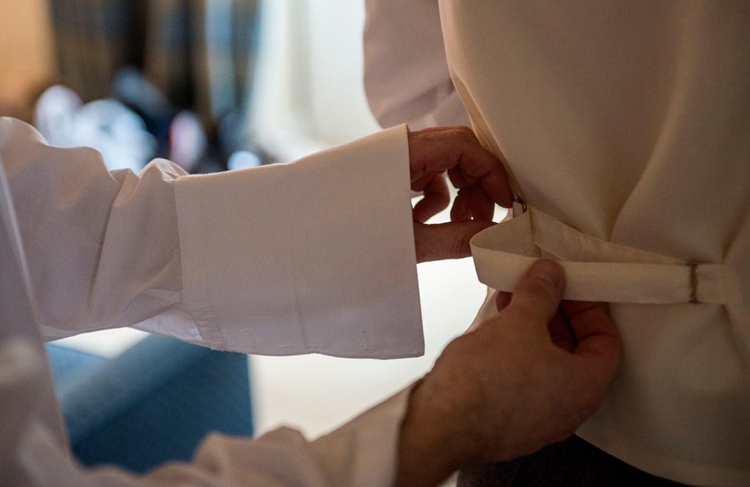 groom dressing wedding photographer in Peterborough