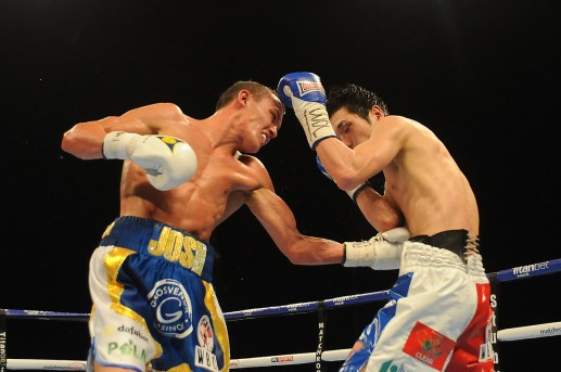 Josh Warrington (white, blue and yellow shorts) defeats Hisashi Amagasa (red, white and blue shorts) on points during a Boxing show at the First Direct Arena on 16th April 2016