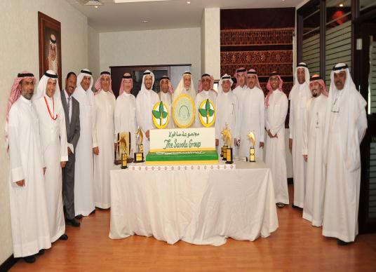 Chairman and board members of the Savola Group celebrating winning the Golden Peacock Global Award for Excellence in Corporate Governance and Transparency