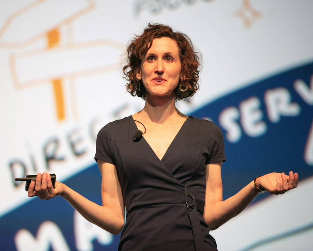 ImageThink Founder and CEO Nora Herting delivering an interactive visual keynote on stage at WBENC.