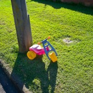 a toy car on the kerbside