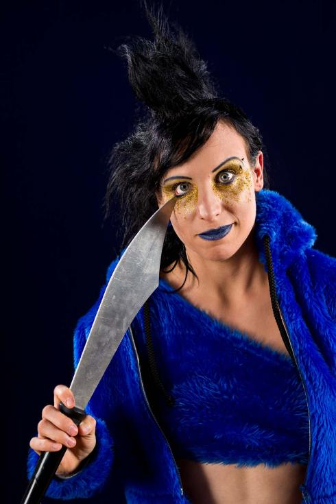 Promotional character portrait of circo arts performer Neisha with a juggling knife.