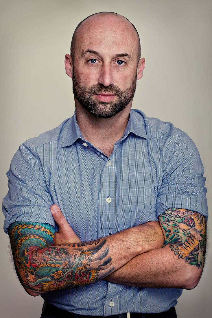 Studio based, editorial style portrait of Craig with tattoos