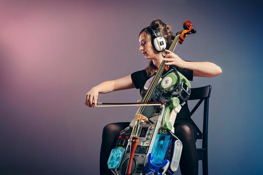 Conceptual studio photography of a cello made out of old tech, used to advertise the Old Tech New Decks performance art at the melbourne fringe festival for a show about new sounds from old technology.