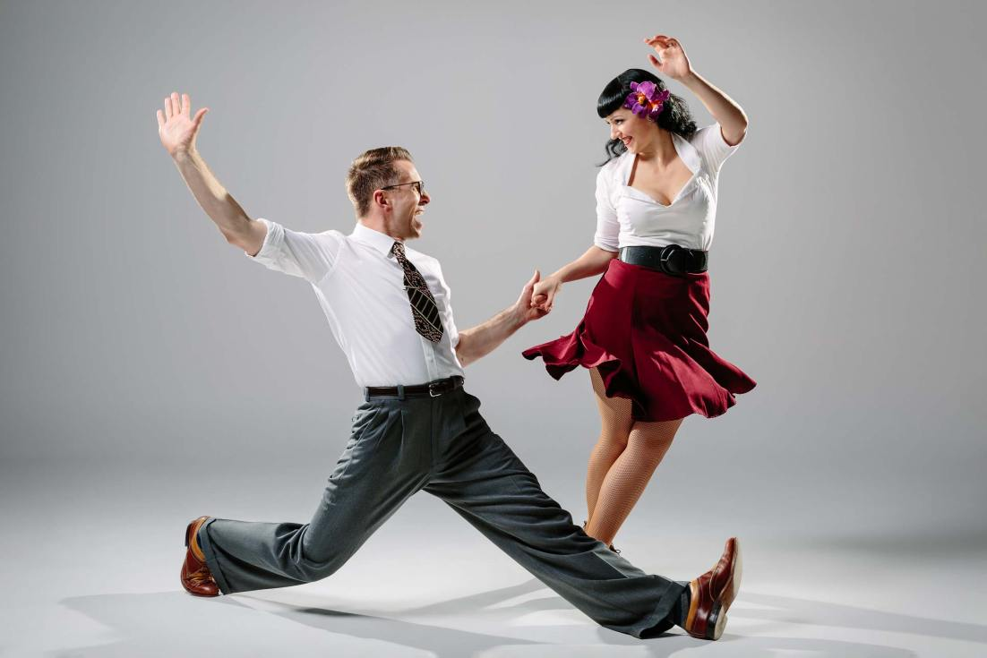 Advertising and promotional photography of swing dancers in the studio