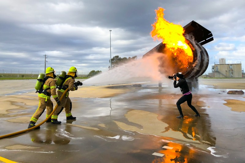 Sharon Blance photographing firefighters on location at Melbourne Airport